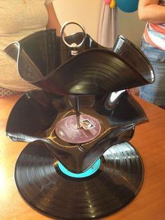 I made this retro cake stand for my 80's party out of old 80's albums ! I think it turned out pretty cool !