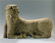 Limestone recumbent bull figure, Tell Brak, Syria, Akkadian, c. 2300-2159 BCE. Eyes created with shell and bitumen inlay. Posture based on earlier Sumerian examples. Figure of human-headed bull is associated with sun god.