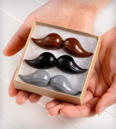 This Mustache Soap Set includes a fancy hand-stamped box, filled with three different-colored mustaches. There are black, brown and gray mustaches, each its own delightfully refreshing scent with notes like smoked firewood, vanilla bean and the Agadir nights blend. The set includes a description of the scents, tied with a red/white bakers twine.