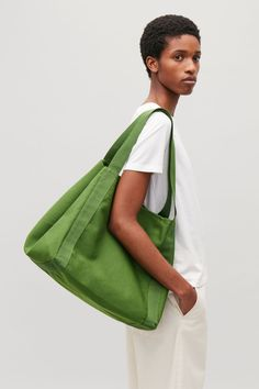 Side image of Cos canvas tote bag in green