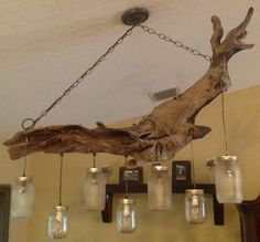 Driftwood Mason Jar Chandelier. This is so cool! Love the earthy look.