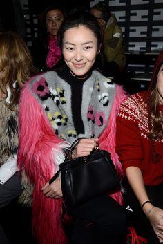 Liu Wen with her Fendi black leather Mini Peekaboo bag at the Fendi FW 13-14 Fashion Show