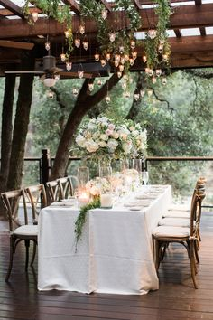 Calistoga Ranch wedding reception, family dinner, suspended florals | Photography: Amanda Wei Photo