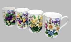 Stunning straight sided floral mugs. Set of 4.  10 ounce capacity. Made in English bone china.  Reminiscent of the florals found in an English Country Garden