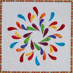 colorful applique quilt, and I love quilting
