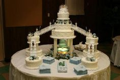 Wedding Cake With Waterfall: This cake was picked out and made for us by our Aunt on my wife's side.  We basically liked it because of the little figures walking down the stairs and