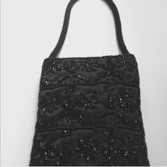 Small beaded purse Sequined handbag. Perfect for a nite out to carry your phone and lipstick. Snap closure. Beaded handle and long strap. Bags