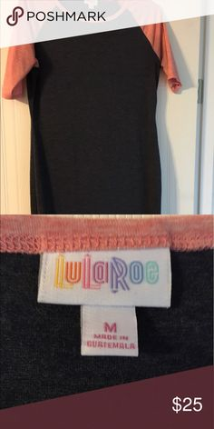 LulaRoe Julia Size Medium Super comfortable Julia for sale! I am now pregnant and need to buy new clothes for this growing belly! 🙈 Worn a few times and washed on gentle cycle and hung to dry. Smoke free home and kept hung up in closet. The colors are light pink and navy blue. This Julia is a tshirt material and so comfortable! I love it paired with a pair of converses LuLaRoe Dresses Midi
