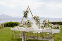 Gentleness and strength blend in Athens, Greece. An approach that combines minimalist wedding design with boho flair to inspire the free-spirited bride. Flower Decorations, Wedding Decorations, Table Decorations, Arch Flowers, Strictly Weddings, Greece Wedding, Wedding Chairs, Muted Colors, Minimalist Wedding