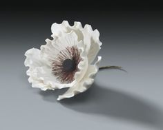 10 White Gum Paste Poppies for Weddings and Cake Decorating - Available in any color. $29.97, via Etsy.