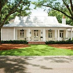 Creole-French-style cottage beckons visitors in with an easygoing porch and a simple, modern design - Breezy River House Exterior - Southern Living Future House, My House, House Porch, Farm House, Tin Roof House, House Front, House With Metal Roof, White Siding House, Metal Roof Houses