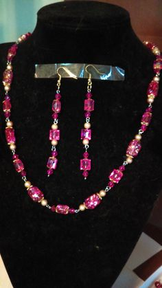 Necklace is 24 in long, earrings 4 in long      Beads- 1/2 inches or smaller ,acrylic ,    gold bead caps , gold hook ,gold and silver ring and eyes pins  earring are gold hook, clips     beads plastic and glass, gold and dark pink beads   Shop this product here: http://spreesy.com/BlueeyesJewelryShop/138   Shop all of our products at http://spreesy.com/BlueeyesJewelryShop      Pinterest selling powered by Spreesy.com