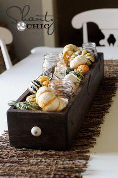 Gourd Centerpiece in a wooden drawer.