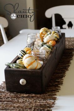 Gourd Centerpiece in a wooden drawer.