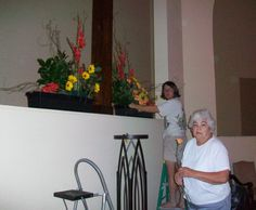 flower arrangers at work -bare foot!  St. Andrew's Worship Center