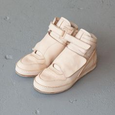 Hender Scheme is a Tokyo-based brand specializing in artisanally-crafted footwear and leather goods. Designed by founder, Ryo Kashiwazaki, each silhouette balances contemporary inspirations with traditional craftsmanship, and is intended to age beautifully with individual use. 100% raw undyed leather sneakers with leather straps and hand-stamped logos on insole. Leather soles are replaceable. Handmade in Japan.