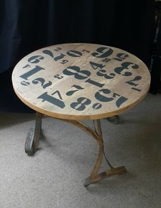 stenciled coffee table of recycled wood & barrel hoops, made by Tonie Snyman of EarthWorks