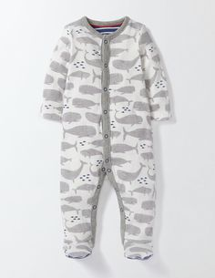 2017 Sleep as deep as the ocean with this whale-print sleepsuit. It's made from supersoft 100% cotton for comfortable nights. Smaller sizes have built-in scratch mitts to keep little ones safe while they slumber. There's a contrasting print on the soles for extra fun when baby waves their legs.