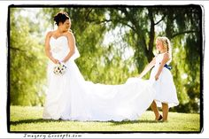 So sweet with the flower girl helping hold the brides dress. Photo by Imagery Concepts photography