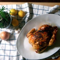 Lemon, Rosemary, and Garlic Whole Roast Chicken Recipe Main Dishes with chicken, lemon, garlic, fresh rosemary, onions, butter, salt, pepper