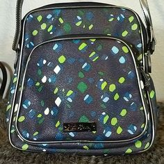 "EUC Vera Bradley Crossbody Excellent used condition Vera Bradley crossbody bag.  9"" w x 9"" high with a 22"" drop that can be let out another 4 "".  No rips, tears, holes.  Looks unused but has a slight cinnamon smell.  Polyvinyl with gunmetal fray trim Vera Bradley Bags Crossbody Bags"