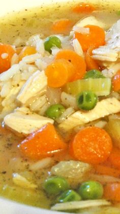 Chicken and Rice Soup ~ chunks of white chicken, celery, onions, carrots and peas with a serving of rice in rich flavorful broth
