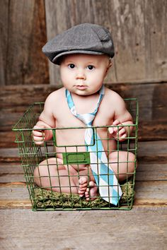 cute baby boy with tie and hat