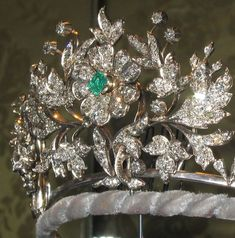 Next up another floral tiara, this one put together for the 18th birthday of Princess Benedikte in 1962. It was adapted from a diamond and emerald brooch originally belonging to Queen Alexandrine, with extra diamond foliates added at the sides to extend it. Even now it can be used as three brooches, and has emerald, diamond and pearl centres to the first flower head