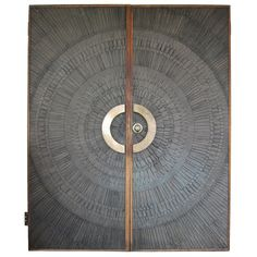 Heroic Sunburst Doors. USA. 1970's. By David Gillespe and Billy Joe McCarroll for Forms and Surfaces. Made of composite, bronze hardwood, bronze hardware and walnut.