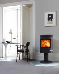 The stoves artistic expression sets it apart from the crowd. Its combination of cast iron and glass are a challenging interpretation of style and function. Wood, Stove, Wood Burning, Home, Hearth, Home Appliances, Morso Stoves, Home Decor, Wood Stove