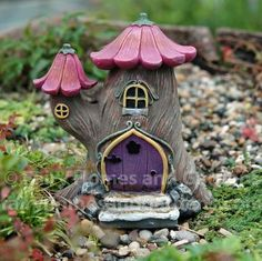 This little tree house has a tulip petal roof and chimney cap and a lovely purple door.