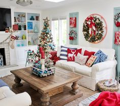 Coastal Christmas decor featuring a palette of red, blue, and turquoise via @gracecottagehhi on Instagram!