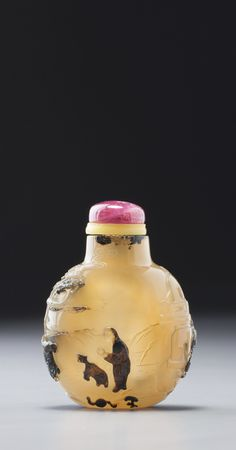 AN INSCRIBED CHALCEDONY 'ROCKY LANDSCAPE' SNUFF BOTTLE<br>SUZHOU, SCHOOL OF ZHITING, QING DYNASTY, 18TH / 19TH CENTURY | lot | Sotheby's