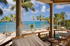A hammock and two outdoor armchairs with neutral cushions provide ample room for kicking back and taking it all in.