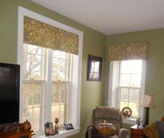 """My client's """"After"""" photo:  With windows having 2 different heights, the design challenge was resolved with inside mounting the valance on the tall window and mounting as high as we could on an outside mount installation on the shorter window.  Now the difference is less awkward."""