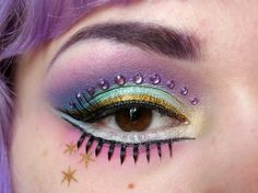 Lilac crystals accent the crease of colorful eye make-up inspired by Princess Celestia of My Little Pony fame.