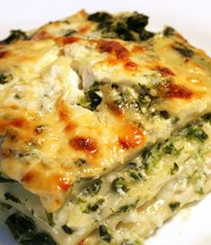 Creamy Perfection Vegetarian Lasagna with Ricotta Cheese 3 ¼ cups Ricotta Cheese 1 ½ cups fresh grated Parmesan cheese 2 boxes Frozen chopped spinach, drained 4 ½ cups chunky vegetable sauce 1 box uncooked Lasagna noodles 2 ½ c grated Gouda or Swiss cheese ⅛ tsp. Salt ⅛ tsp. pepper