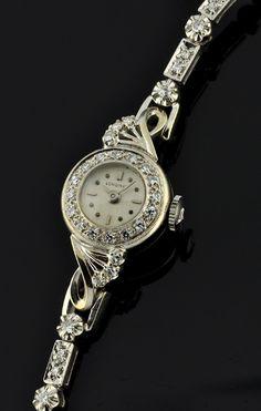 1940s solid white gold & diamond Longines.