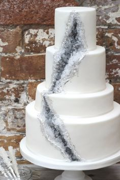 Geode cakes made from rock candy to mimic the rock's crystalline texture, and they are taking the wedding cake world by storm.