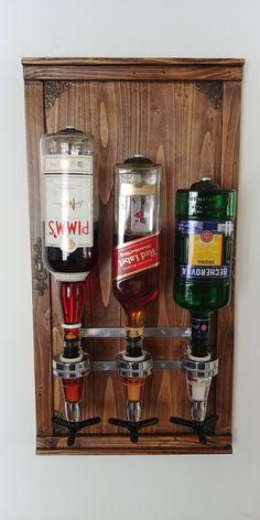 Whiskey Liquor Wall Mount Dispenser /Alcohol dispenser/ 3 bottle holder /wood dispenser /gift for him /gift for dad/ for husband. Whiskey Dispenser, Alcohol Dispenser, 21st Birthday Gifts For Guys, Gifts For Dad, Wooden Gifts, Handmade Wooden, Alcohol Storage, Handmade Gifts For Men, Beer Opener
