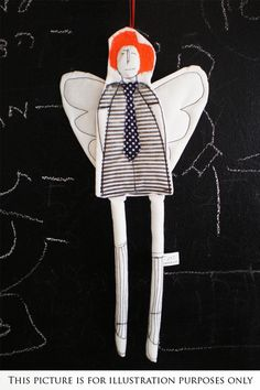 Wall hanging ornament - Black and white Guardian Angel Wearing  striped dress and a blue polka dot tie . timo - handmade fabric Wall art. $32.00, via Etsy.