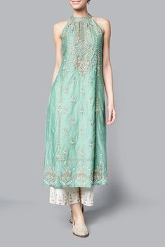 indian designer wear Subtle hues of summer blend with floral motifs of regal Rajasthani gardens in this sage tunic. The sleeveless embroidered Aasiya tunic, in chanderi mull, will Kurta Designs Women, Salwar Designs, Blouse Designs, Indian Wedding Outfits, Indian Outfits, Bridal Outfits, Wedding Dresses, Indian Attire, Indian Wear