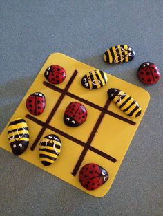Tic-tac-toe game made from bees and ladybug painted rocks. This one was bought at a craft fair but we then made our own, first by collecting flat rocks at the beach, then painting them, and then we made a board out of felt.Tic-tac-toe game made from bees Lady Bug Painted Rocks, Painted Rocks Kids, Stone Crafts, Rock Crafts, Arts And Crafts, Rock Painting Ideas Easy, Rock Painting Designs, Diy For Kids, Crafts For Kids