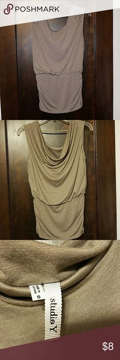 Maurices Studio Y slouch back blouse This top is so cute with jeans and boots or even jeans shorts and wedges. The banded waist is 8 inches. It has metallic embellishment on each shoulder. The back has a string that goes across the back. Perfect condition- worn 1 time. Maurices Tops Tank Tops