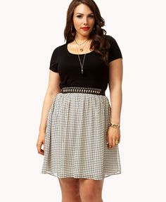 #forever21 A jersey skater dress featuring a chiffon skirt with a grid pattern. Round neckline. Short sleeves. Shirred waist.