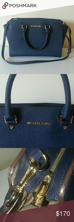 Michael kors large navy selma Beautiful and in Great condition large MK selma in navy blue with gold accents. Very clean in the inside with a minor tiny blue stain as shown in picture. Michael Kors Bags Satchels