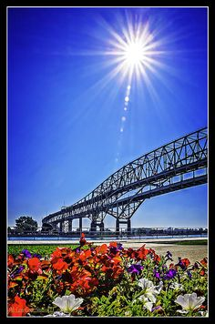 The Blue Water Bridge By LeeAnn McLaneGoetz McLaneGoetzStudioLLC.com  The Blue Water Bridge is at the juncture of Lake Huron and the St. Clair River. It is a must see destination for all that travel to Michigan via the Blue Water Bridge. Port Huron / Fort Gratiot Michigan. #bluewater Bridge,#Michigan