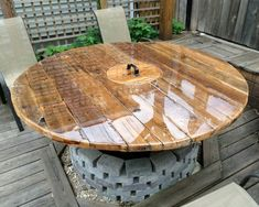 This table has removable legs that allow for it to be placed directly into this brick fire pit.The center of the table is removable as well - revealing a small charcoal grill - perfect for entertaining - you can BBQ your food and never leave your seat Wooden Spool Tables, Cable Spool Tables, Wooden Spools, Bbq Table, Patio Table, Pub Tables, Diy Patio, Wine Barrel Fire Pit, Custom Dog Houses