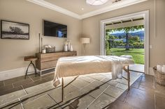 Napa Valley Farmhouse with Neutral Interiors - Massage Room with garden views