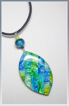 Sea Blue Faux Dichroic Leaf Pendant, polymer clay Jewelry. BeadazzleMe, via Etsy.